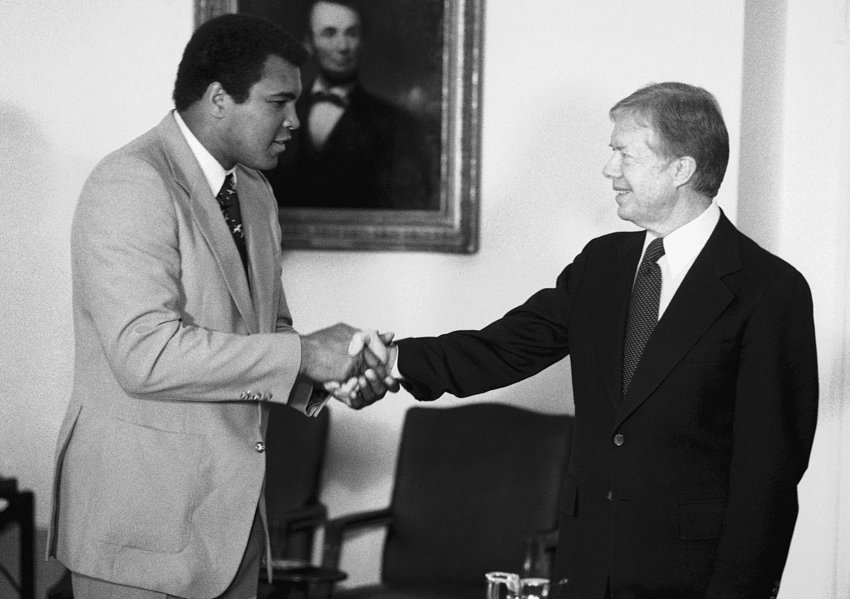 Muhammad Ali shaking hands with President Jimmy Carter at the White House on February 11, 1980. The boxing champ had just returned from a disastrous diplomatic mission in Africa to rally support for Carter's boycott of the Olympics. Within a year, both men would face the end of their respective careers.