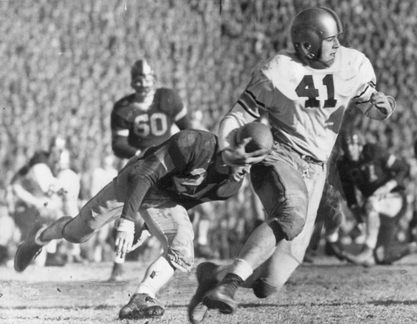 Army's Glenn Davis eludes Navy tacklers at the 1944 Army-Navy game in Baltimore, Maryland. As World War II was raging overseas, the Black Knights faced the Midshipmen for the national championship, defeating them 23-7 in the most highly-anticipated game of the year.
