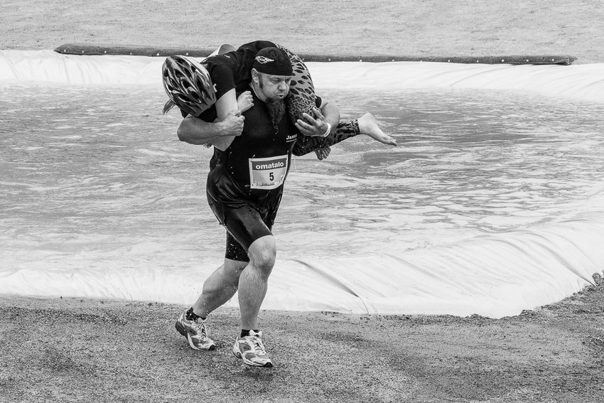 A competitor makes his way through the course at the Wife-Carrying World Championships held annually in Finland. With their Olympic glory days behind, the Finns are perfectly content taking to offbeat athletic competitions.