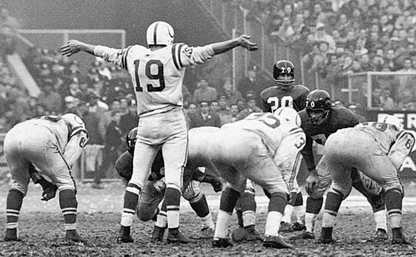 Quarterback Johnny Unitas of the Baltimore Colts calling a play at the 1958 NFL championship, the team's first national title. The deep-rooted franchise would abandon their fans 30 years later for Indianapolis.