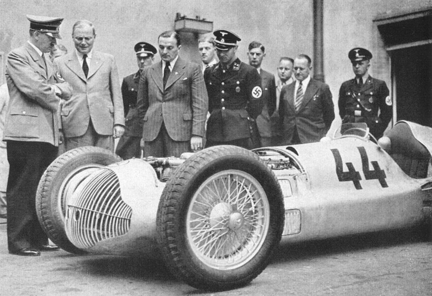 Adolf Hitler (far left) inspecting one of the 'Silver Arrows' developed by Mercedes and Auto Union. With government subsidies, the race cars were used to showcase Nazi propaganda as they dominated the Grand Prix circuits in the 1930s.