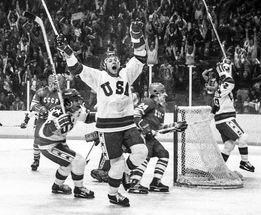 Team USA celebrates its winning goal over the USSR at the 1980 Winter Olympics. Skating on the left is Mike Eruzione, team captain who placed the puck in the net to make it 4-3.