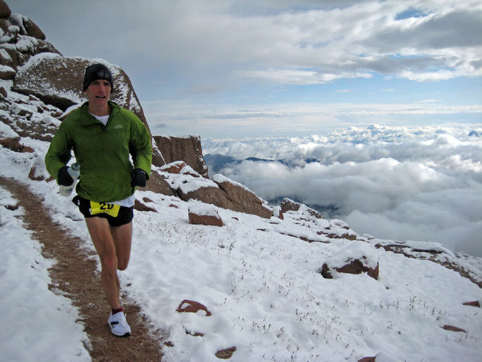 Matt Carpenter, 12-time champion of the Pike's Peak Marathon, making his way down from the 14,115-foot summit. Along with the century-old Hill Climb car race, Pike's Peak has mixed sports with a pioneering spirit.