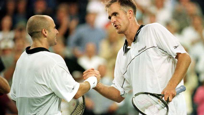 Todd Martin (right) congratulates Andre Agassi for winning the 1999 US Open. Martin was twice a grand slam finalist: at the 1994 Australian Open where he lost to Pete Sampras in 3 sets and at the 1999 US Open where he succumbed to Agassi in a 5-set, hard-fought duel.