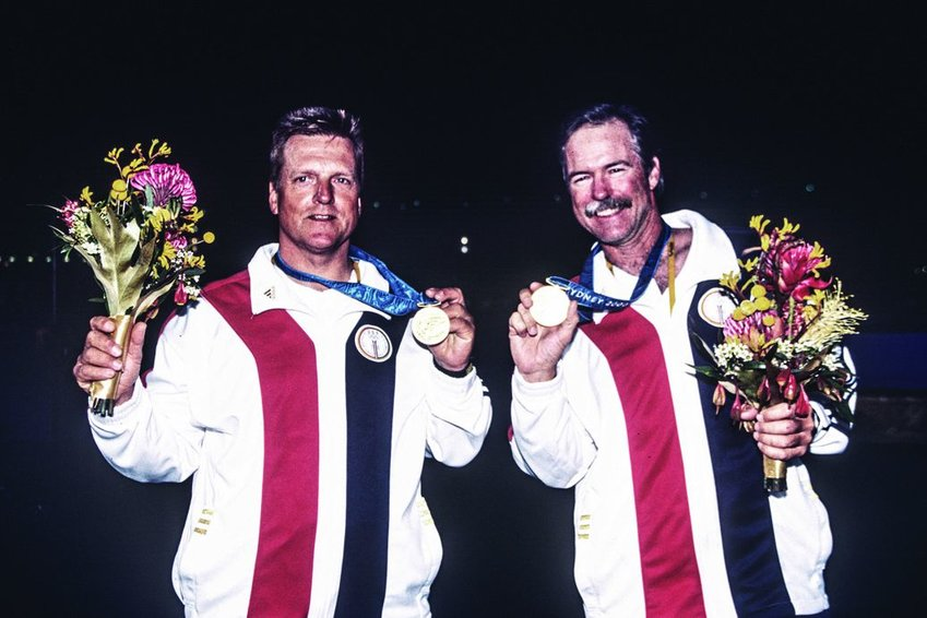 Mark Reynolds (right) and his partner Magnus Liljedahl displaying their gold medal after winning the Star class regatta at the 2000 Sydney Olympics.