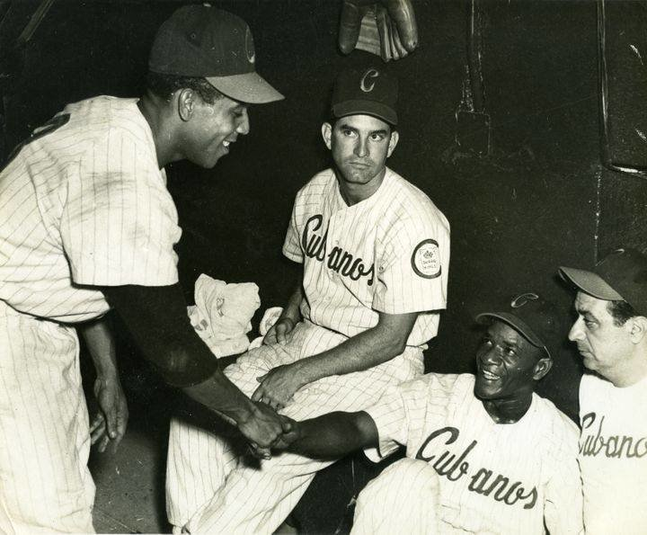 Members of the Havana Sugar Kings in the dugout during one of their games. In far right is Reggie Otero, who managed the club from 1954-57.