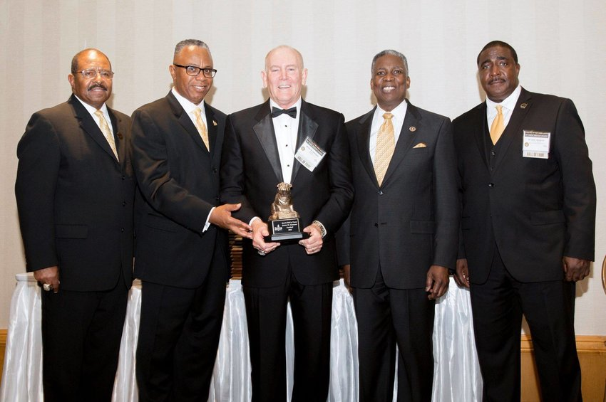 Rickie Simmons (3rd from left) at the Bowie State College Hall of Fame induction ceremony in 2016. As the team's leading wide receiver in the 1970s, he was the only white player in an all-black team at an HBCU.
