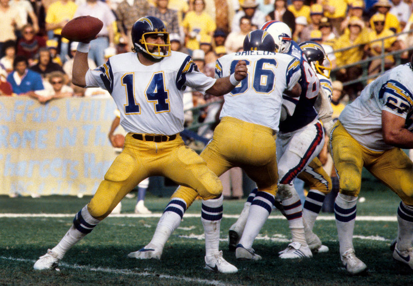 Dan Fouts launching against the Buffalo Bills during the 1980 AFC Divisional Playoff Game. Fouts spent 15 years with the San Diego Chargers, followed by 30 years in broadcasting.