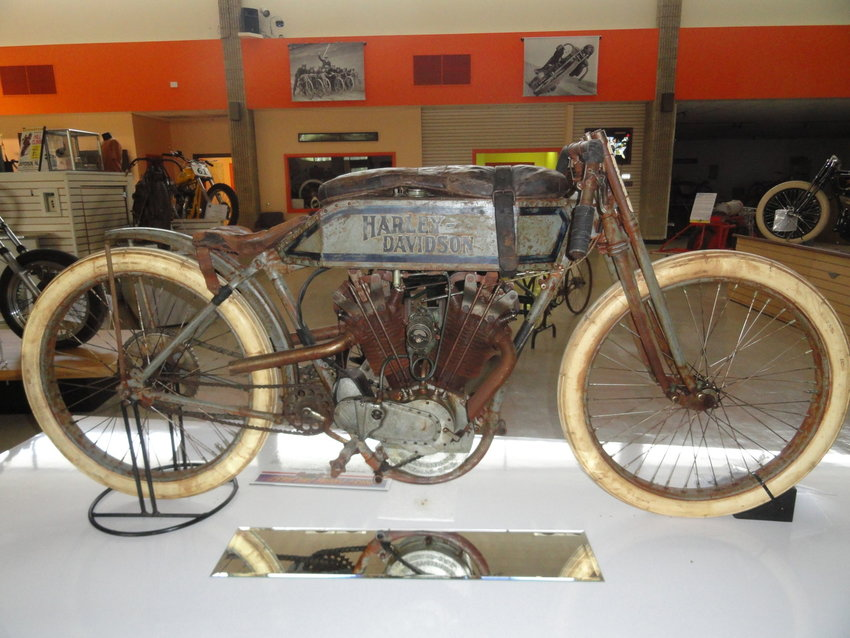 A 1915 Harley-Davidson Dodge City racer shown at the Motorcyclepedia Museum in Newburgh, NY. Note the leather pad wrapped on the fuel tank that allowed rider to lay down his chest and minimize wind resistance during the race.