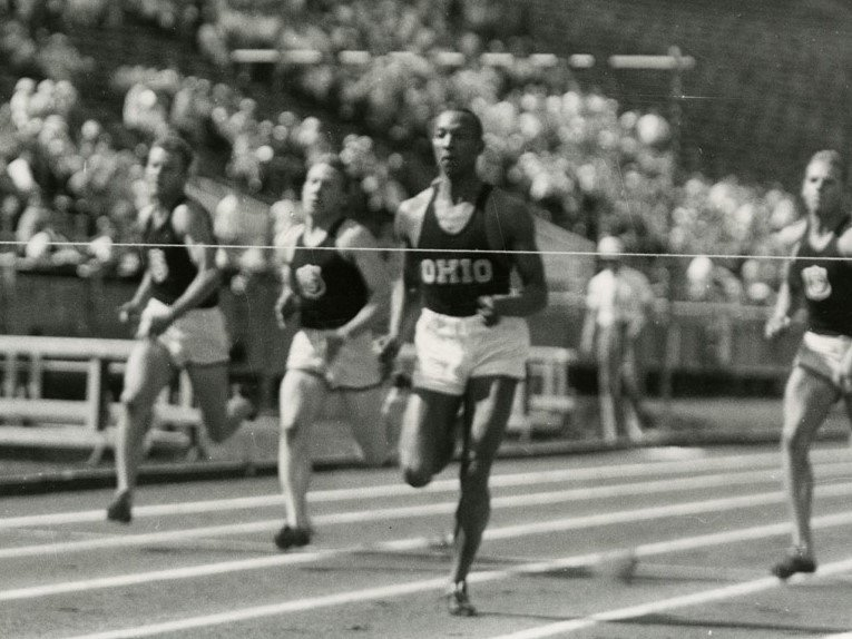"Jesse Owens moments before clearing the finish line for Ohio State University.  A year before his triumph at the 1936 Olympics, the college sophomore achieved the ""greatest 45 minutes in sports""."