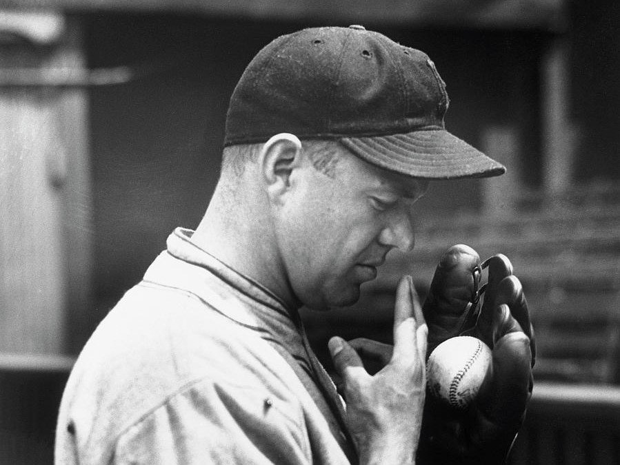 Burleigh Grimes wetting his fingers before launching a spitball pitch.  Outlawed by MLB in 1920, the spitball was still allowed to be thrown by 17 pitchers who were exempt from the restriction.  Grimes was the last to hurl a legal spitball when he retired in 1934.