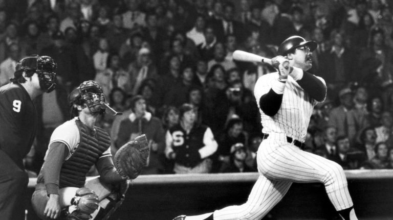 "Reggie Jackson, nicknamed ""Mr. October"" for his post-season clutch hitting, blasting his third home run at Game 6 of the 1977 World Series between the New York Yankees and the Los Angeles Dodgers.  He was the first player to hit three home runs in a single World Series game since Babe Ruth."