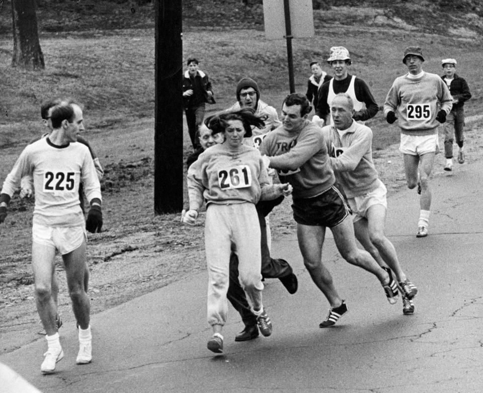 "Kathrine Switzer attacked from behind by a race official who tried to remove her from the 1967 Boston Marathon.  With other runners coming to her aid, she would finish the race and become the first official female Marathon runner.  A photo of the incident was flashed around the world and is in Time-Life's book, ""100 Photos that Changed the World."""