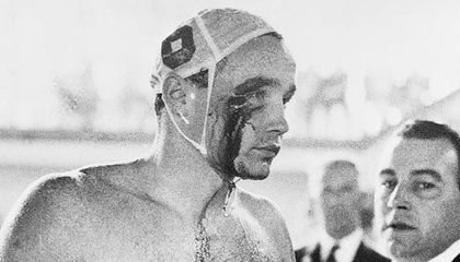 Ervin Zador of the Hungarian water polo team emerges from the pool at the 1956 Olympics with a bloodied face after being punched by his Soviet counterpart, Valentin Prokopov.  With profound political overtones, the Hungarians won the semi-final match 4-0 before going on to claim the gold medal.