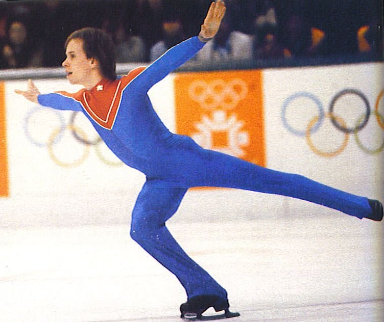 "Scott Hamilton at the 1984 Winter Olympics in Sarajevo where he won gold in figure skating.  A champion several times over, Scott went on to a successful career in ice entertainment with ""Ice Capades"" and then with his own troupe, ""Stars on Ice"".  Battling cancer in childhood and in his adult years, Scott was an inspiration to millions of people."