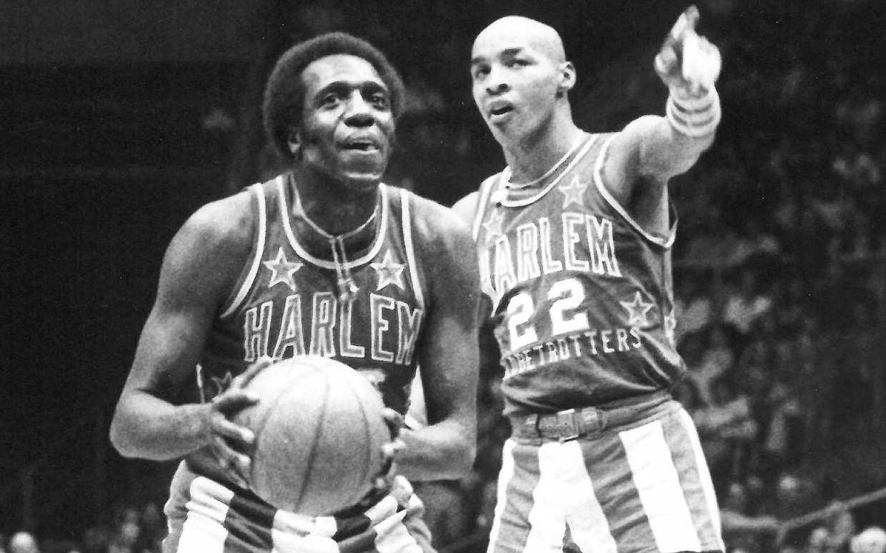 Curly Neal (right) who died on March 26, 2020, and Meadowlark Lemon (left) who died in 2015, performing one of their game antics as members of the Harlem Globetrotters.  They belonged to the last generation of Globetrotters who showcased basketball wizardry around the world before the NBA took off in the 1980s.