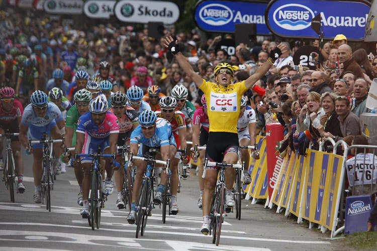 Alberto Contador celebrating his first Grand Tour victory at the 2007 Tour de France. One of the greatest racers of all time, he would win the Tour again in 2009, the Giro d'Italia 2x, and the Vuelta a Espagna 3x. He is only one of two cyclists to have won each Grand Tour at least twice.