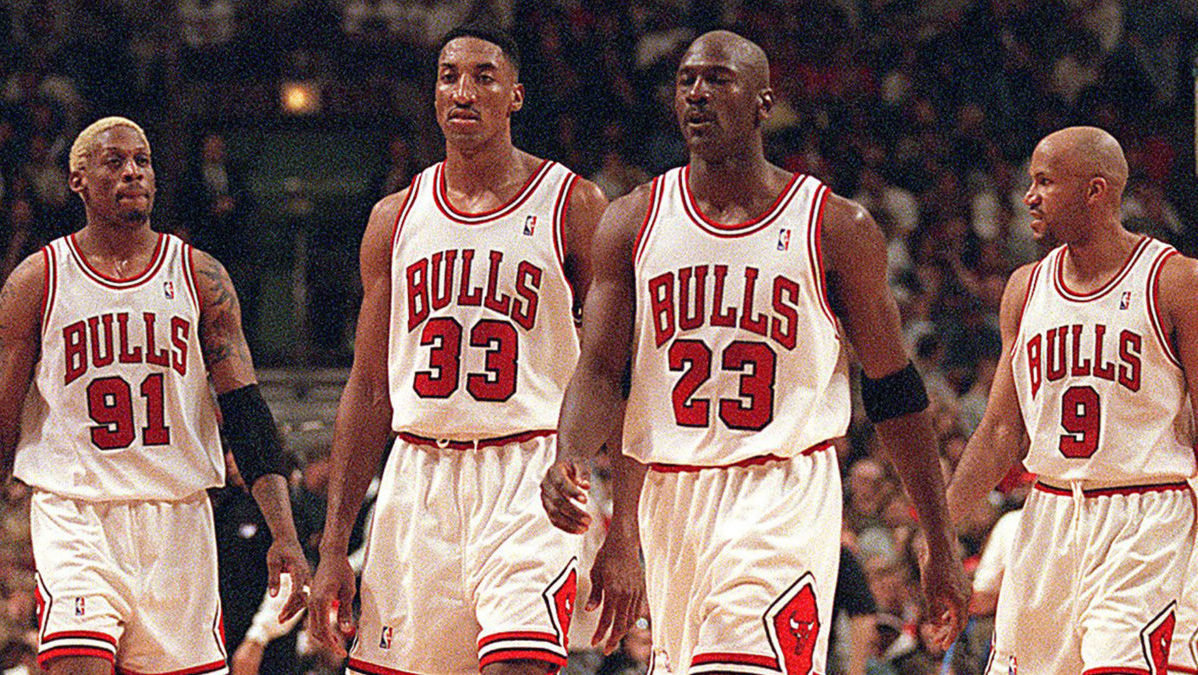"Chicago Bulls players from left: Dennis Rodman, Scottie Pippen, Michael Jordan and Ron Harper. Jordan and the Bulls are subject of ""The Last Dance"", a 10-part Netflix series that takes a deep dive into the team's dual 3-peats in the 1990s."