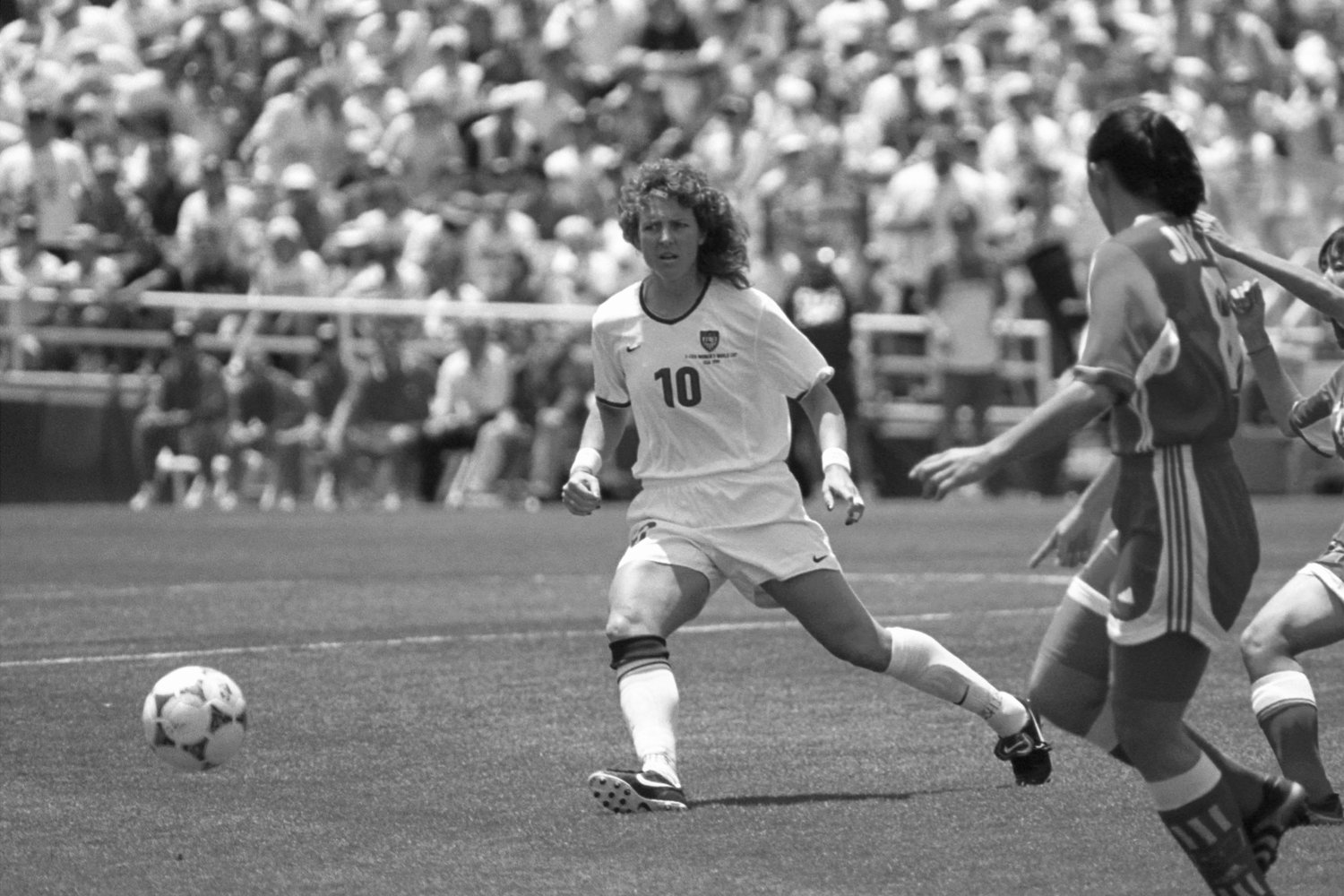 Michelle Akers in action at one of the United States Women's National Team games. As the first female global soccer star, Akers lent her unmatched heading skills and finishing touches to 2 FIFA Women's World Cup Championships (1991, 1999) and the Olympics (1996).