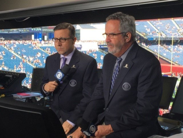 Ian Eagle (left) at the CBS broadcasting booth with Hall of Fame quarterback, Dan Fouts. Eagle has worked with dozens of renowned broadcasting partners over the course of his career, including 10 years with Fouts.