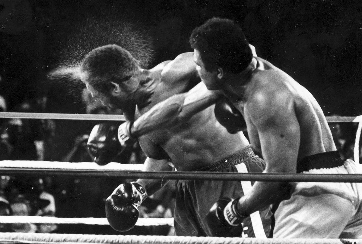 "Muhammad Ali landing a punch on George Foreman at their 1974 epic ""Rumble in the Jungle"" bout in Kinshasa, Zaire. The fight was the subject of a documentary called ""When We Were Kings"", directed by Leon Gast who died on March 8th, 2021."