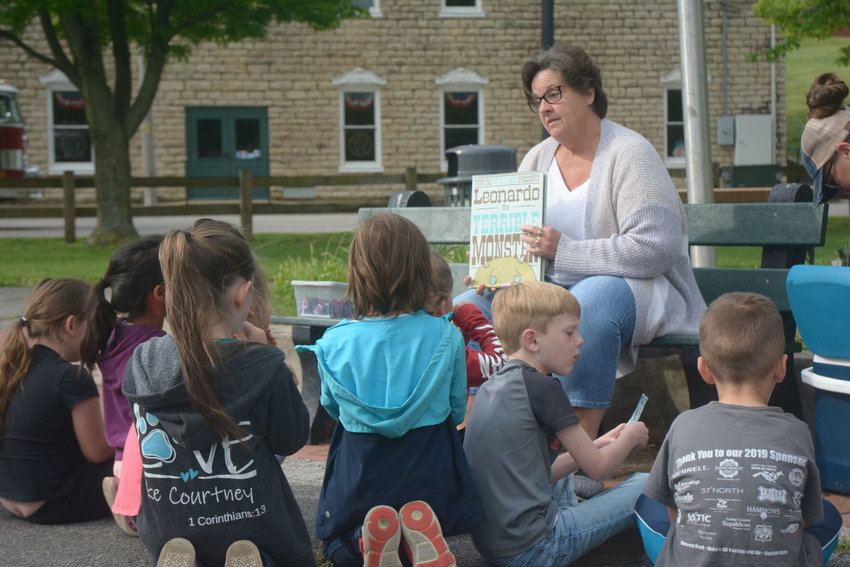 "Willa Tucker of the Stockton Area Chamber of Commerce reads kindergarten students ""Leonardo the Terrible Monster"" at the Stockton City Park on Friday, May 14."
