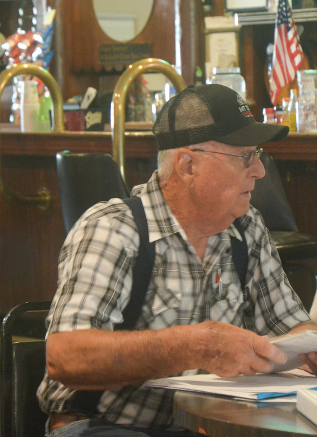 AmVets member Sonny Ross reads off the previous meeting's minutes during a regular meeting at Post 116 Saturday, July 17.