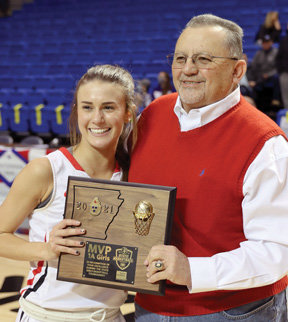 Abbey Linville receives the MVP trophy from Farm Bureau agent Shane McElroy.