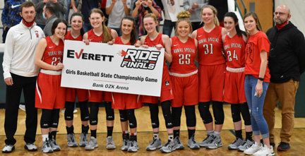 "The Rural Special senior girls basketball team post with their ""ticket"" to the Class 1A Championship."