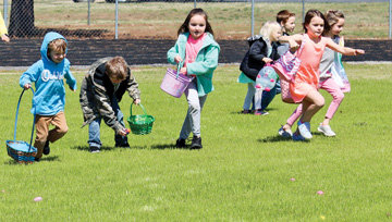 Mountain View kindergartners run to find eggs on the football field during an Easter egg hunt April 2.