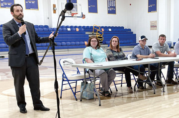 Financial advisor Michael McBryde speaks to the public at the May 6 meeting.