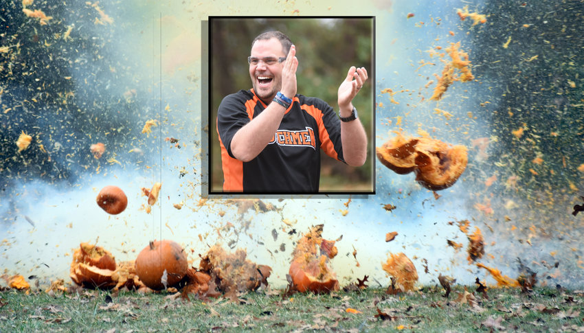 KEVIN LAY reacts last spring as pumpkins explode during a physics lesson at Owensville Gun Club. A rifle round fired by the school district's resource police officer detonated a Tannerite charge during the lesson.