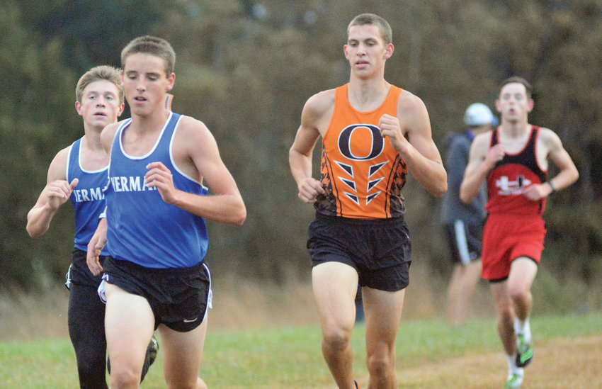 Austin Terry (above, third from left) chases Hermann Bearcat harriers Carter Hemeyer (above, far left) and Dalton Gleeson (second, from left). Union's Dominick Beine trails the Gasconade County trio during the varsity boy's race in last Tuesday's Owensville Cross Country Invitational ran throughout the R-2 Campus.
