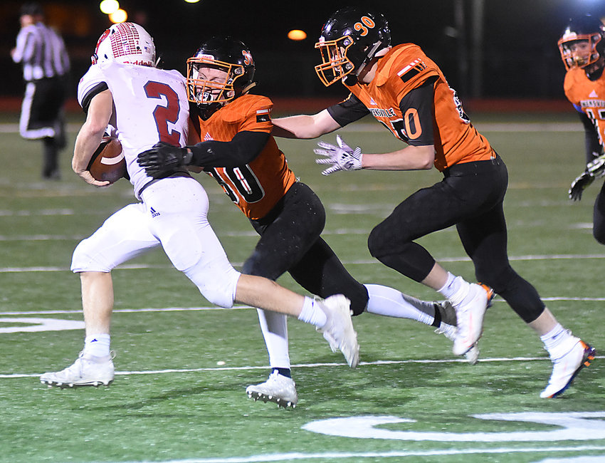Trenten Watkins (center) works to bring down St. Clair's Dalton Thompson (2) during Owensville's 52-6 loss to the visiting Bulldogs Friday night in the regular-season finale at Dutchmen Field. Nathan Cabot's Dutchmen will open the MSHSAA Class 3, District 2 Tournament Friday night at Sullivan with a 7 p.m., kickoff.