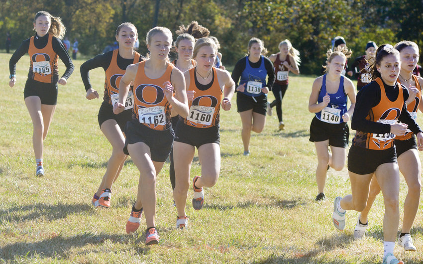 Dutchgirl harriers (from left) Macy McKinney, Arissa Huff, Mekayla Gibson, Kiera Finn, Katie Candrl, Sophia Ashner and Kendra Hults begin their race to a third consecutive district title Saturday morning at Big Driver in Washington.