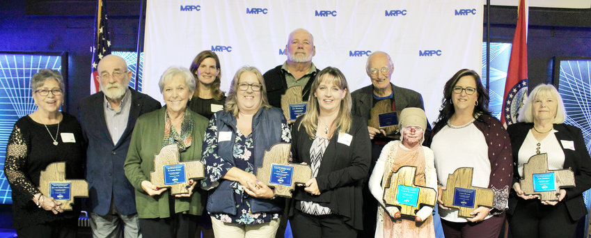 "Meramec Regional Planning Commission's 2019 award recipients include (from left) Jan and Terry Primas of Waynesville, E. Louise Baker of Owensville, Julia Semsick of Crocker, Paula Shockley and Leann Smith accepting the Eugene E. Northern Award on behalf of their mother, Faye Howard of Cuba, Joey Butler, Sr., of Belle, Dr. Donald ""Doc"" Broman of Linn, Karlee Hallahan of Vienna, Cindy Butler of Belle, and Judy Apperson of Salem. Not present for the group photograph was award recipient William ""Bill"" S. Jenks, III, of Rolla. Unable to attend were award recipients Patricia Heaney of Hermann, and Shane Jones of Belle."