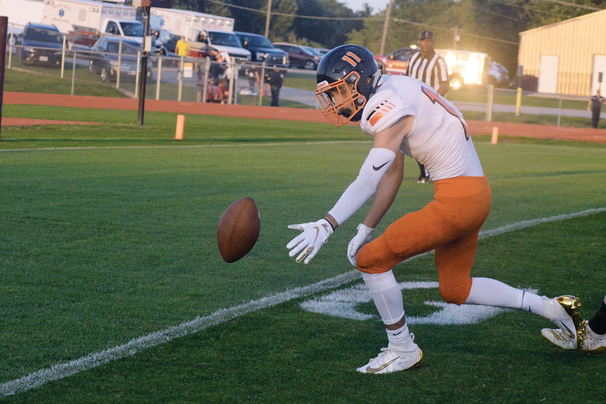 Cason Gray reaches for a deflected football near the goal line at Victor Field during Owensville's week two victory on the road over Eldon's Mustangs.