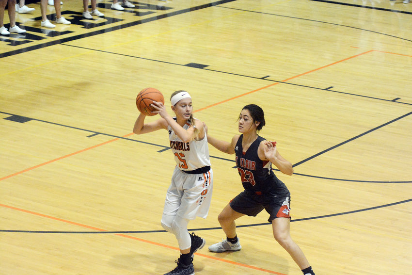 Kate Angell (above, left) looks to push the basketball up the floor with St. Clair's Alohilani Bursey during Owensville's 67-44 loss to the Lady Bulldogs in the Four Rivers Conference (FRC) opener for both teams Monday night.