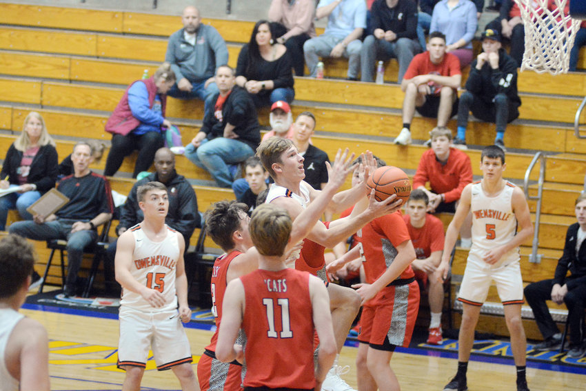 Brendan Decker (above, center) goes up amongst the Union Wildcat defense attacking the basket during Owensville's 65-57 victory over the Wildcats giving them seventh place at the 67th Borgia Turkey Tournament and snapping a 14-game losing streak against Four Rivers Conference (FRC) teams dating back nearly two years.