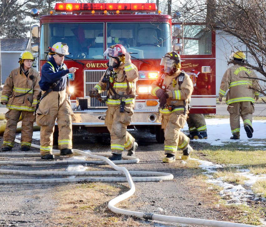 Owensville fire Assistant Chief Jeff Arnold makes manpower assignments at the scene of a Dec. 21 fire which destroyed an Owensville residence. Firemen extinguished the fire quickly but extensive damage was reported to the structure and contents. The rescue truck behind them was purchased used from the city of Washington's fire department to replace one damaged in a crash earlier in 2019.