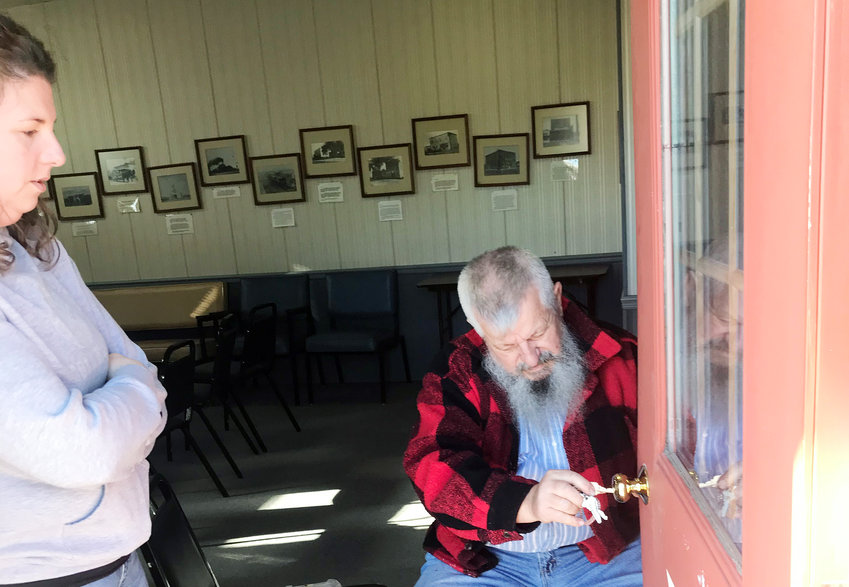 Steve Grgurich (above, right) and his daughter, Stephanie, spent much of New Year's Day finding replacement parts and repairing the door to the Depot in Legion Park that had been kicked in. Another door in the park was also damaged and showed signs of having been kicked in.