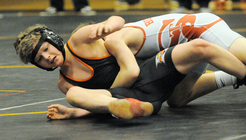 Michael Martin (above) works to keep his back off the wrestling mat against St. Clair's Ryan Meek during a Four Rivers Conference (FRC) quad meet at Sullivan High School last Wednesday. Martin lost by technical fall 15-0 before going on to win by forfeit against Sullivan and pin St. James' Teagan Kelly 1:18 at 106 pounds.