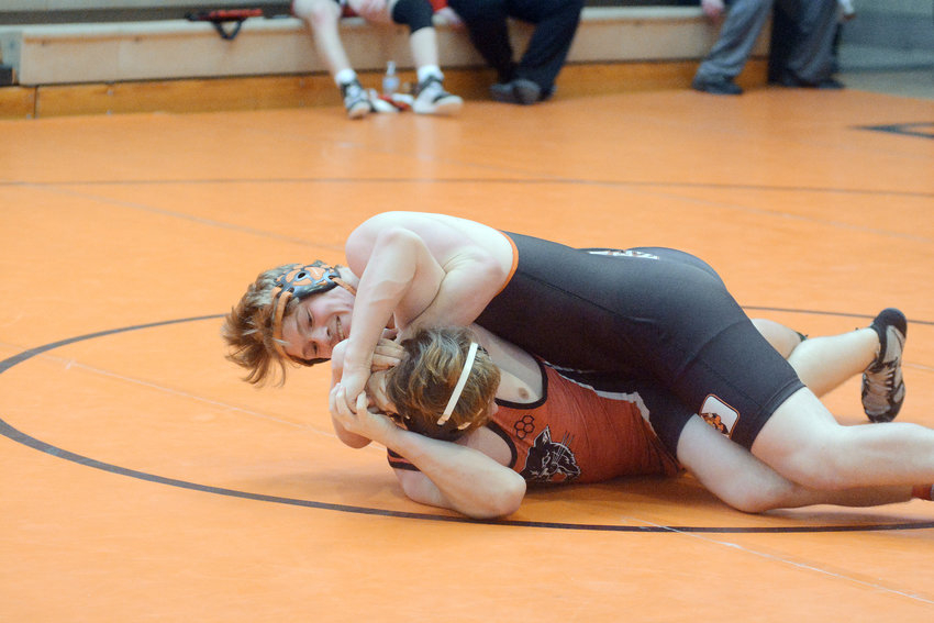 Dakota Martin (black singlet) works on putting Dexter's Shawn Robards during fourth-round wrestling action in the 195 'B' pool during Saturday's 25th Annual Owensville Dutchmen Wrestling Invitational which could have easily been cancelled for the second year in a row due to winter weather. Martin went on to win the weight class.