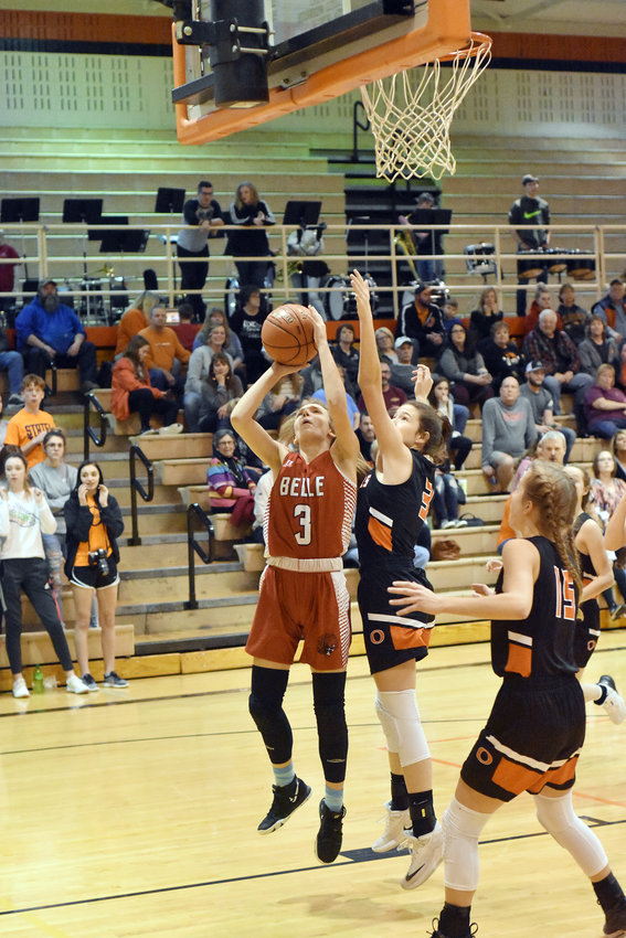 Hali Naber (above, left) gets in position to take a shot with Owensville's Leah Reed right behind her looking to block it. Owensville went on to defeat Naber and Belle's Lady Tigers 48-40 in the third game of a Highway 28 basketball quadrupleheader Monday night at Owensville High School. OHS will host Hermann Friday night for winter homecoming.