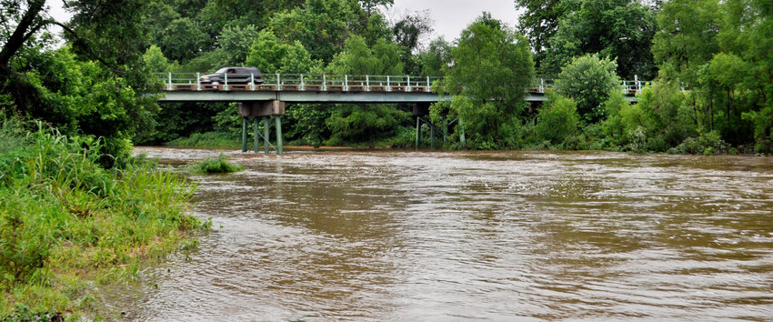 ThIRD CREEK flows under the Route A bridge during a period of heavy rainfall runoff in June of 2015. The existing 65-year-old bridge will be replaced this year.