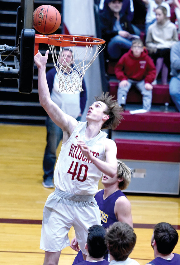 LINN SENIOR Drew Voss gets way up for a nice basket  in Friday's win over Chamois.