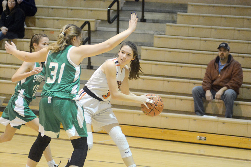 Leah Reed (above, far right) looks for a open Dutchgirl basketball teammate to pass the ball to Monday night during junior-varsity action against the visiting New Haven Lady Shamrocks. Even though New Haven took the two-quarter JV game 18-17, Owensville came back to handily win the varsity contest 49-21.