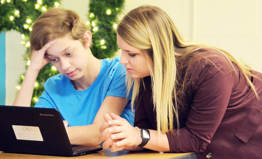 Kelley Rosemann works Monday with a student on a classroom assignment. She was named assistant principal on Feb. 17.