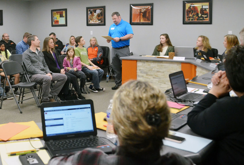 Gasconade County R-2 Activities Director Ryan Okenfuss speaks at last month's School Board meeting.