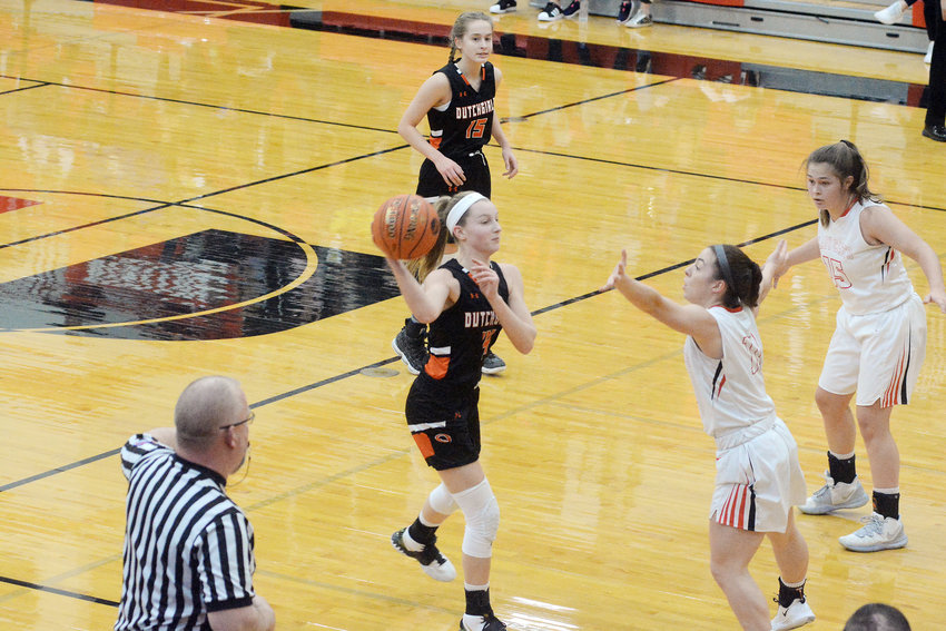 Anna Finley (left) looks to pass the ball around Union's Reagan Rapert during first-round action at the MSHSAA Class 4, District 9 Basketball Tournament at Union High School last month.
